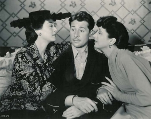 Russell, Don Ameche, and Kay.