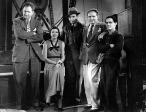 On the set of 1935's Stranded. From left: Daves, Kay, George Brent, Frank Borzage & player.