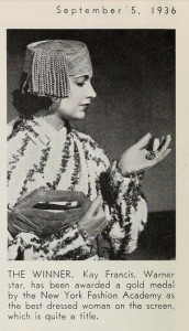 From a September 1936 issue of the Motion Picture Herald. Kay receiving the award from the New York Fashion Academy.