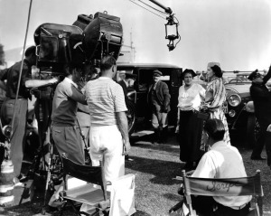 Curtiz (striped shirt) directing Kay & Alison Skipworth in Stolen Holiday, 1937.